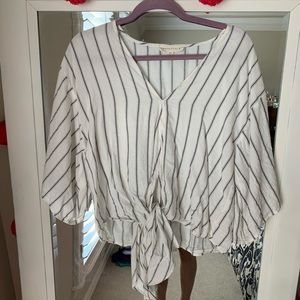 Cream blouse with bell sleeves and front tie